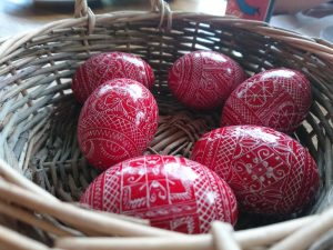 Bunch of wooden and painted easter eggs in a basket